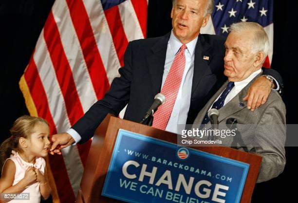 S Sen Joe Biden pinches the cheek of his granddaughter Natalie Biden as he embraces Deleward Democratic Party State Chairman John Daniello while...