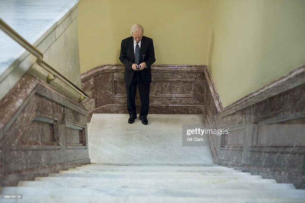 Sen. Joe Lieberman, I-Conn., types on his blackberry before making his way to the Senate Democratic Policy lunch on Tuesday, Sept. 22, 2009.