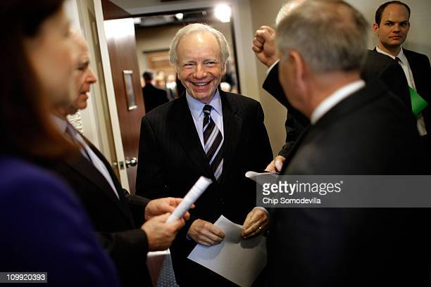 Sen Joe Lieberman talks with fellow senators before a news conference at the US Capitol March 10 2011 in Washington DC In the same week that...