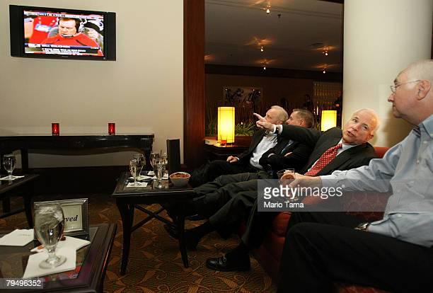 US Sen Joe Lieberman US Sen Lindsey Graham Republican presidential candidate and US Sen John McCain and former US Sen Phil Gramm watch the Super Bowl...