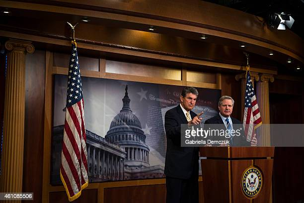 Sen. Joe Manchin , and Sen. John Hoeven , speak to reporters at a news conference on the legislation to approve the Keystone XL pipeline project...
