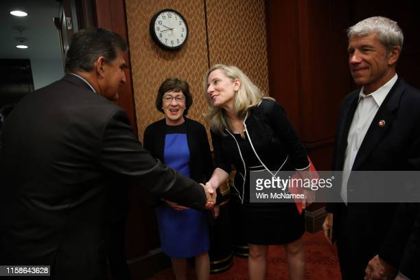 Sen. Joe Manchin greets Rep. Abigail Spanberger before a press conference held by the bipartisan and bicameral Problems Solvers Caucus at the U.S....
