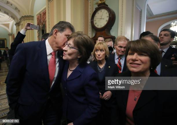 Sen. Joe Manchin , , kisses Sen. Susan Collins , as they celebrate with fellow Senators after the Senate voted and passed the a CR to reopen the...