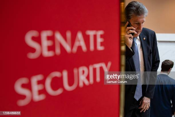 Sen. Joe Manchin leaves a briefing for Senators by officials from the Department of Homeland Security, Federal Bureau of Investigations, Director of...