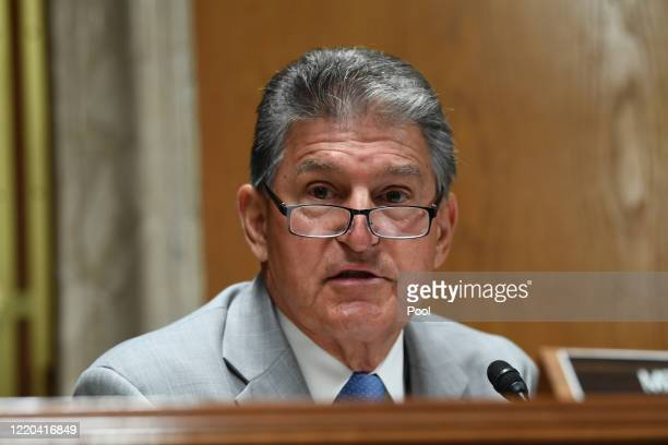 Sen. Joe Manchin questions Ajit Pai, Chairman of the Federal Communications Commission, during his testimony before an oversight hearing to examine...