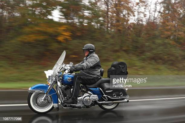 Sen. Joe Manchin rides his motorcycle as he campaigns ahead of midterm elections at the WRNR Radio on November 5, 2018 in Martinsburg, West Virginia....
