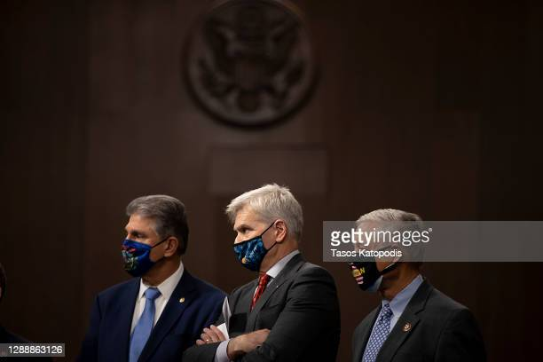 Sen. Joe Manchin , Sen. Bill Cassidy and Rep. Fred Upton stand alongside a bipartisan group of Democrat and Republican members of Congress as they...