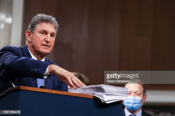 Sen. Joe Manchin speaks alongside a bipartisan group of Democrat and Republican members of Congress as they announce a proposal for a Covid-19 relief...