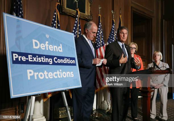 Sen Joe Manchin speaks on a proposed protection plan for people with preexisting health conditions during a news conference on Capitol Hill July 19...