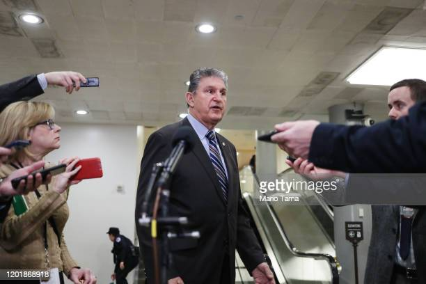 Sen. Joe Manchin speaks to reporters before walking into the U.S. Capitol from the Senate subway for impeachment trial proceedings against President...
