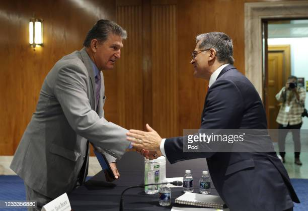 Sen. Joe Manchin, talks with Xavier Becerra, Secretary of the Department of Health and Human Services , before a Senate Appropriations Subcommittee...