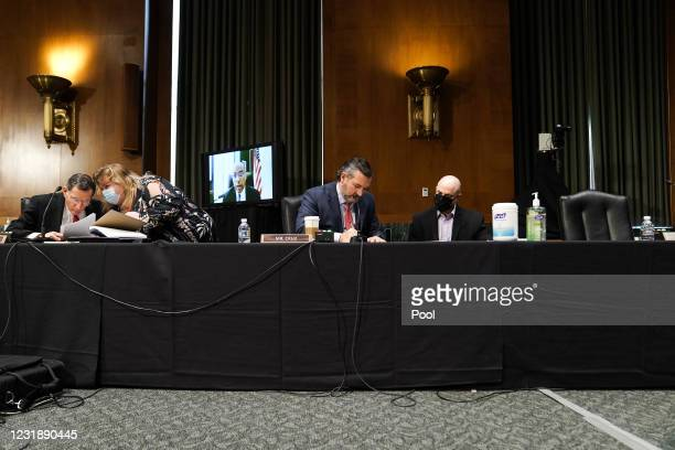 Sen. John Barrasso and Sen. Ted Cruz confer with aides at the confirmation hearing for Samantha Power, nominee to be Administrator of the U.S. Agency...