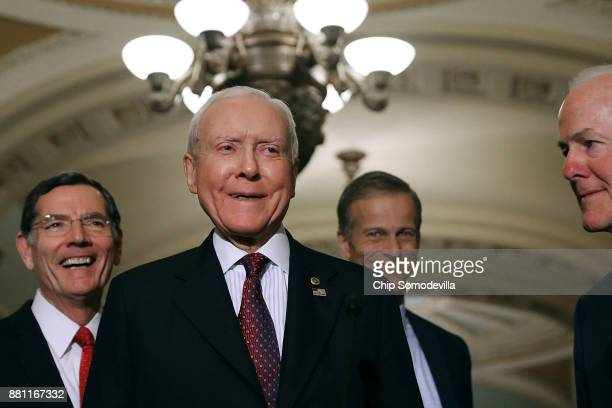 Sen John Barrasso Senate Finance Committee Chairman Orrin Hatch Sen John Thune and Senate Majority Whip John Cornyn talk with reporters following the...
