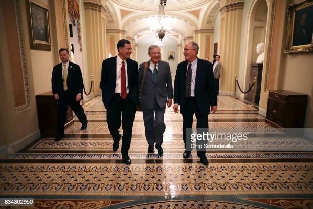 Sen John Barrasso Senate Majority Leader Mitch McConnell and Sen Lamar Alexander walk thorugh the US Captiol after the Senate confirmed Sen Jeff...