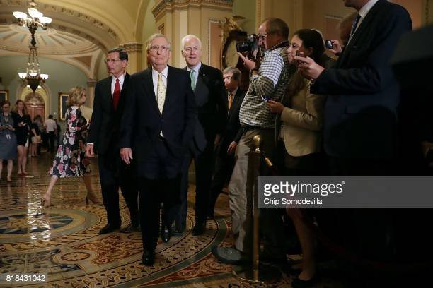 Sen John Barrasso Senate Majority Leader Mitch McConnell and Senate Majority Whip John Cornyn prepare to speak to reporters following the weekly...