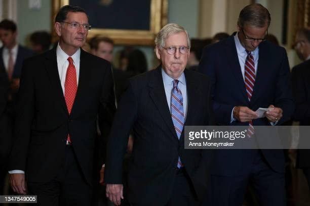 Sen. John Barrasso , Senate Minority Leader Mitch McConnell and Senate Minority Whip Sen. John Thune walk to address reporters following a weekly...