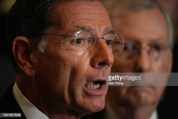 S Sen John Barrasso speaks as Senate Majority Leader Sen Mitch McConnell listens during a news briefing after a weekly Senate Republican policy...