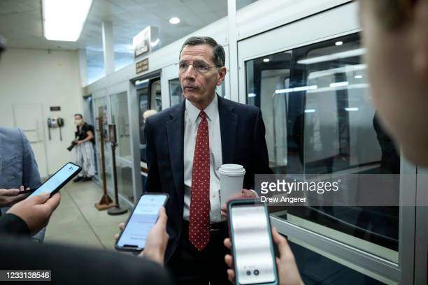 Sen. John Barrasso talks with reporters after a vote at the U.S. Capitol May 27, 2021 in Washington, DC. The mother of late Capitol Police Officer...
