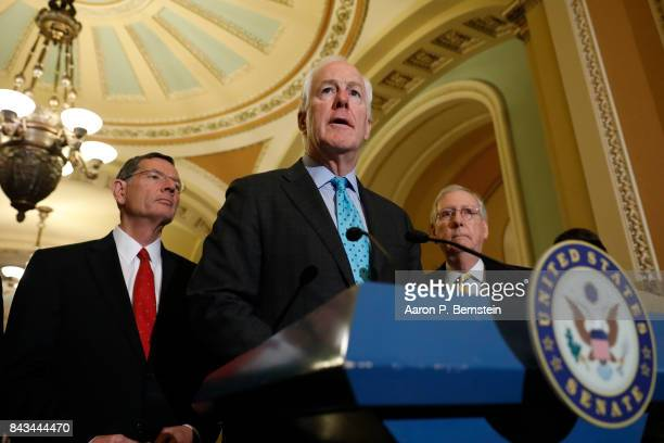 Sen John Cornyn accompanied by Sen John Barrasso and Senate Majority Leader Mitch McConnell speaks with reporters following the weekly Senate...