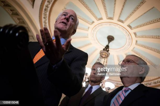 S Sen John Cornyn accompanied by Sen John Thune and Senate Majority Leader Mitch McConnell speaks with reporters ahead of the weekly policy luncheons...