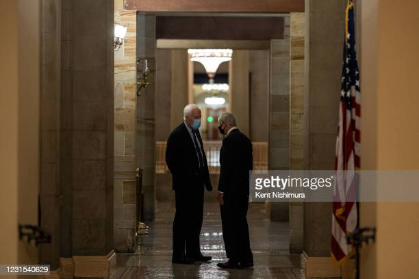 Sen. John Cornyn and Sen. Tom Carper discuss the COVID19 relief bill in a hallway on the Senate Side of the Capitol Building on Friday, March 5, 2021...