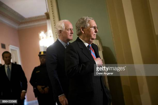 Sen John Cornyn and Senate Majority Leader Mitch McConnell leave a meeting with Senate Republicans on Capitol Hill December 5 2017 in Washington DC...