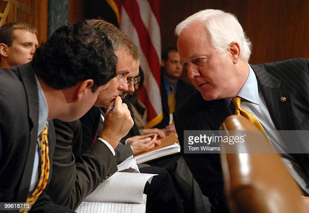 Sen. John Cornyn, R-Texas, confers with staff during a Senate Judiciary Committee hearing on proposals to limit Guantanamo detainees' access to...