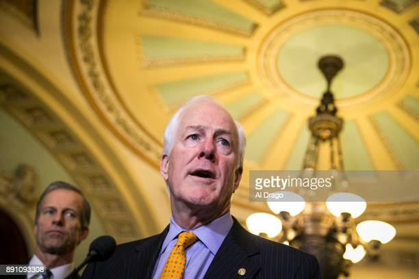 Sen John Cornyn speaks to reporters about the Alabama Senate race during a news conference on Capitol Hill December 12 2017 in Washington DC At left...