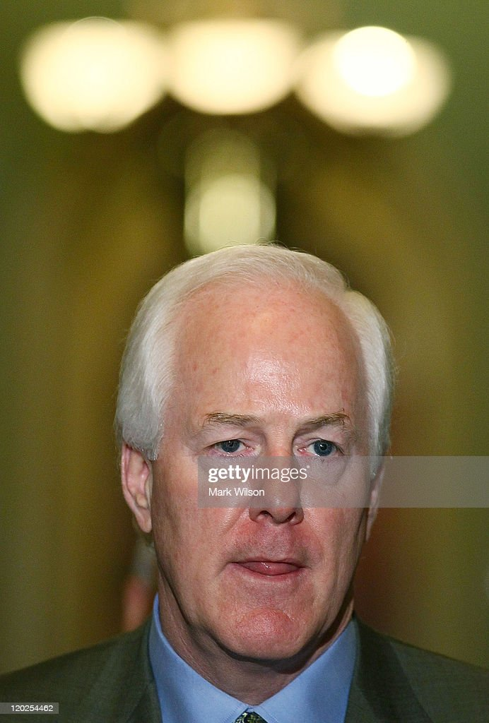 U.S. Sen. John Cornyn (R-TX) speaks to the media following the vote to raise the dept limit at the U.S. Capitol on August 2, 2011 in Washington, DC. Washington, DC. The Senate voted 74-26 to approve the bill to raise the debt ceiling, allowing the U.S. to avoid default on its debts.