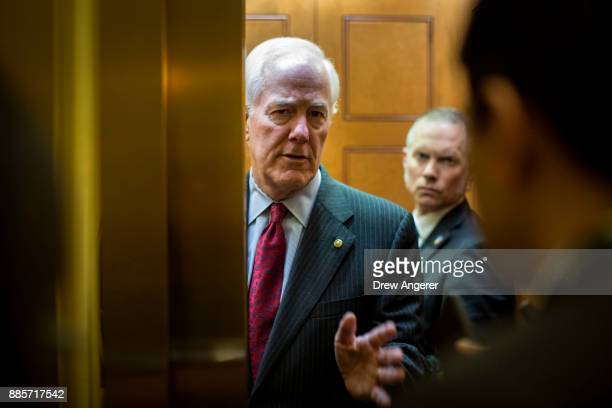 Sen John Cornyn talks with reporters about tax reform legislation on Capitol Hill December 4 2017 in Washington DC The House voted to formally send...