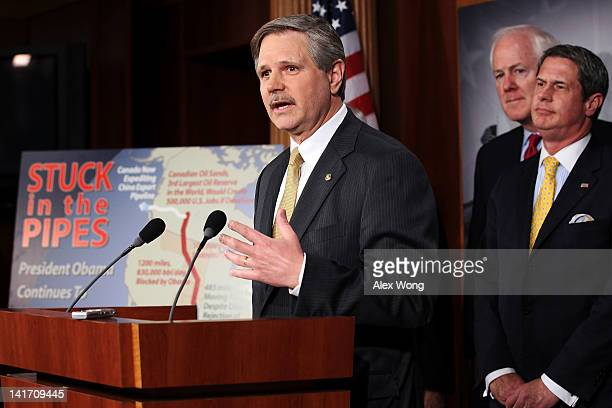 S Sen John Hoeven speaks as Sen John Cornyn and Sen David Vitter listen during a news conference March 22 2012 on Capitol Hill in Washington DC The...