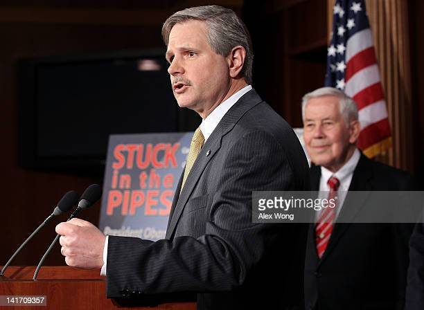 S Sen John Hoeven speaks as Sen Richard Lugar listens during a news conference March 22 2012 on Capitol Hill in Washington DC The Republican...