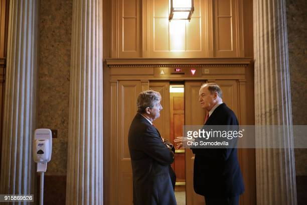 Sen John Kennedy and Sen Richard Shelby visit in the hall sof the US Captiol following a Republican caucus luncheon February 8 2018 in Washington DC...