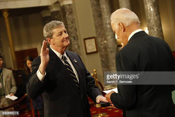 S Sen John Kennedy participates in a reenacted swearingin with US Vice President Joe Biden in the Old Senate Chamber at the US Capitol January 3 2017...