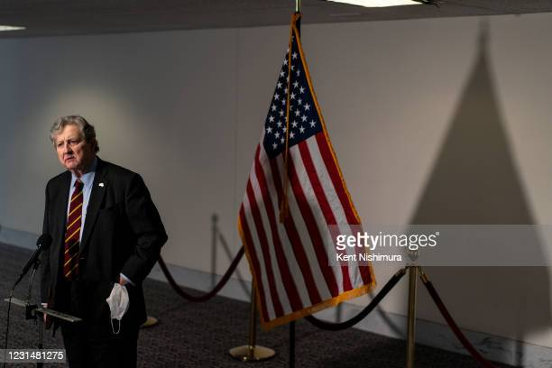 Sen. John Kennedy speaks to a reporter as FBI Director Christopher Wray speaks during a Senate Judiciary Committee hearing on Capitol Hill on...