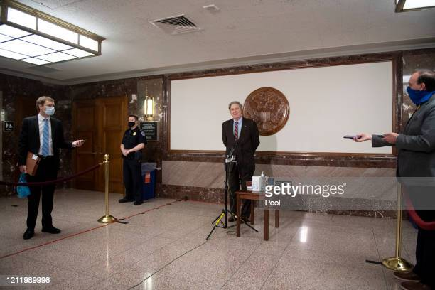 Sen John Kennedy speaks to reporters before attending a Senate Judiciary Committee nomination hearing for Justin Reed Walker to be United States...