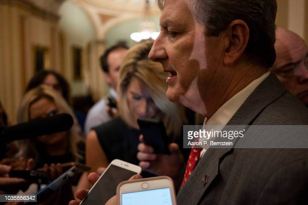 Sen John Kennedy speaks with reporters ahead of the weekly policy luncheons on Capitol Hill September 18 2018 in Washington DC Senate Majority Leader...