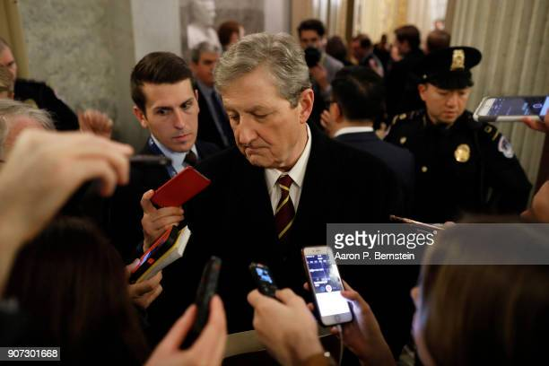Sen John Kennedy speaks with reporters outside the Senate chamber at the US Capitol January 19 2018 in Washington DC A continuing resolution to fund...