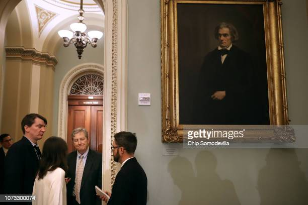 Sen John Kennedy talks with reporters before heading into the weekly Senate Republican policy luncheon in the US Capitol November 27 2018 in...