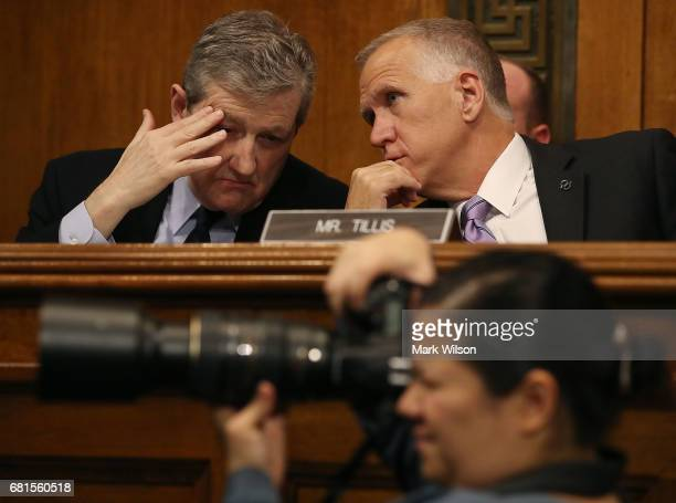 Sen John Kennedy talks with Sen Thom Tillis during at Senate Judiciary Committee confirmation hearing for Justice Department nominees on Capitol Hill...
