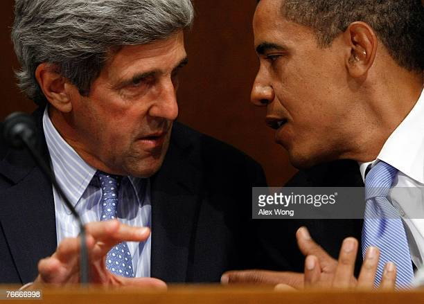 Sen John Kerry and Sen Barack Obama confer during testimony from US Ambassador to Iraq Ryan Crocker and General David Petraeus during a hearing of...