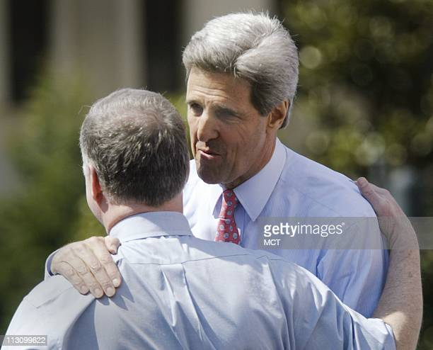 WASHINGTON DC Sen John Kerry gets a hug of support from Howard Dean at George Washington University's Kogan Plaza during a campaign stop in...