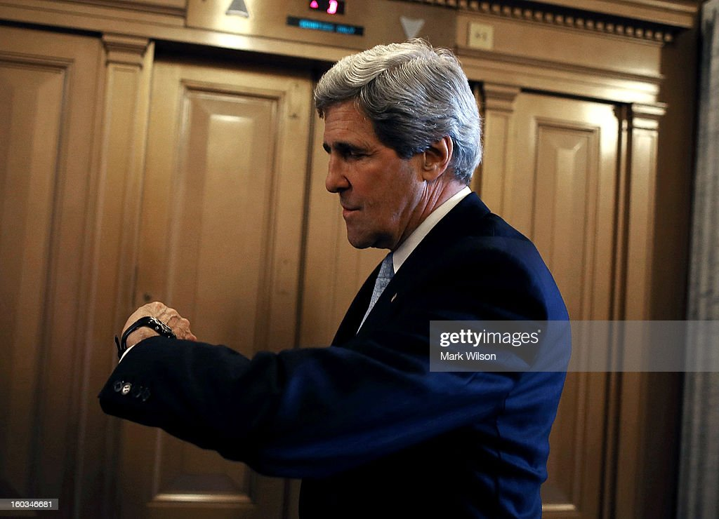 U.S. Sen. John Kerry (D-MA) looks at his watch while waiting for an elevator after the full Senate voted on him to become Secretary of State, on January 29, 2013 on Capitol Hill in Washington DC. The Senate confirmed Kerry to be Secretary of State with a 94 to 3 vote.