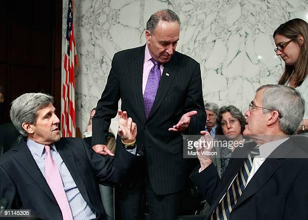 Sen John Kerry Sen Charles Schumer and Sen Jeff Bingaman confer during a Senate Finance Committee mark up session on health care reform legislation...