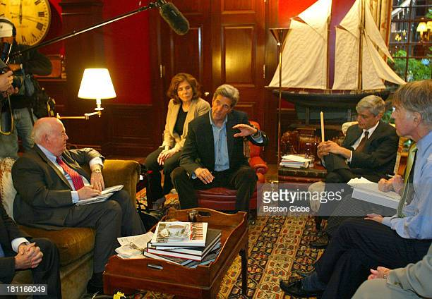 Sen John Kerry speaks with the media inside his home at Louisburg Square on Beacon Hill during a meeting with his economic team From left to right...