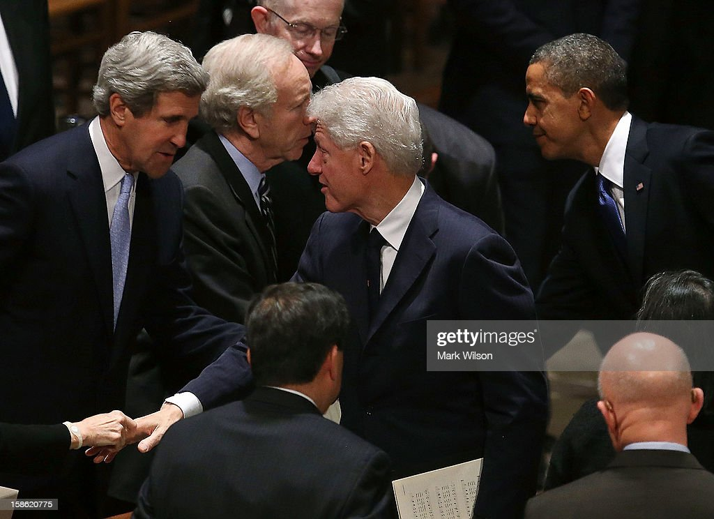 Sen. John Kerry (D-MA) (L) talks with former U.S. President Bill Clinton (C) as President Barack Obama (R) stands nearby during the funeral service for the late Sen. Daniel Inouye (D-HI) at the National Cathedral on December 21, 2012 in Washington, DC. Later today President Obama is expected to nominate Senator Kerry as Secretary of State to replace Secretary of State Hillary Clinton, who will not serve a second term.