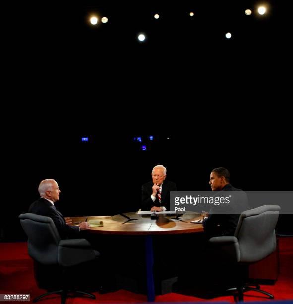 Sen. John McCain and Democratic presidential candidate U.S. Sen. Barack Obama debate as moderator Bob Schieffer of CBS listens during the third...