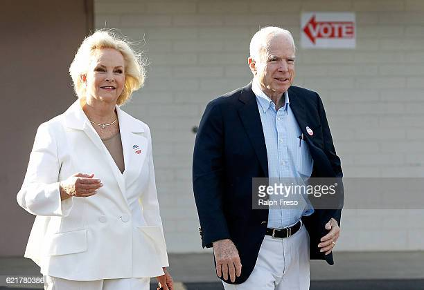 Sen John McCain and his wife Cindy exit the Mountain View Christian Church polling place after casting their vote on November 8 2016 in Phoenix...