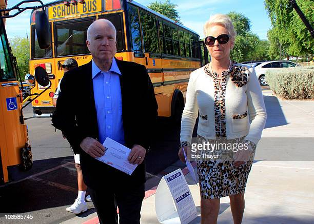 S Sen John McCain and his wife Cindy McCain arrive at Madison Camelview Elementary School to cast their ballots in Arizona's primary election August...