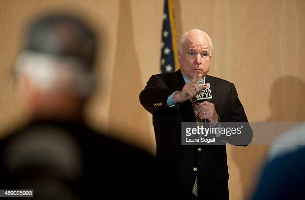 Sen John McCain answers questions during a forum with Arizona Veterans over mismanagement at the Phoenix VA May 9 2014 at the Burton Barr Central...